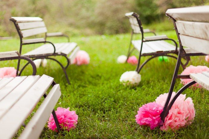 Garden wedding ceremony with paper pompoms