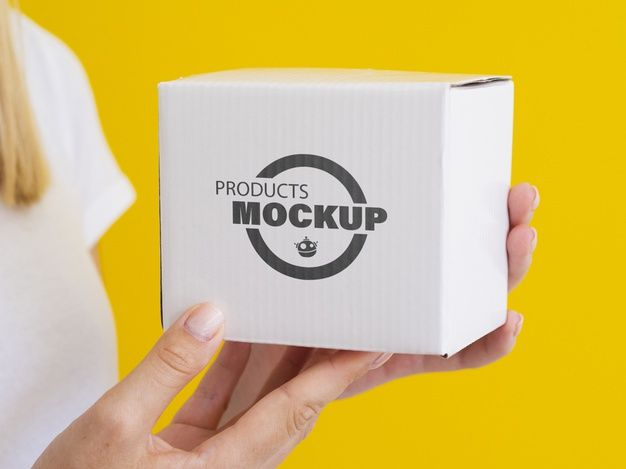 Download Download Woman Holding Up A White Box Mock Up For Free Pink Jewelry Box White Box Free Packaging Mockup
