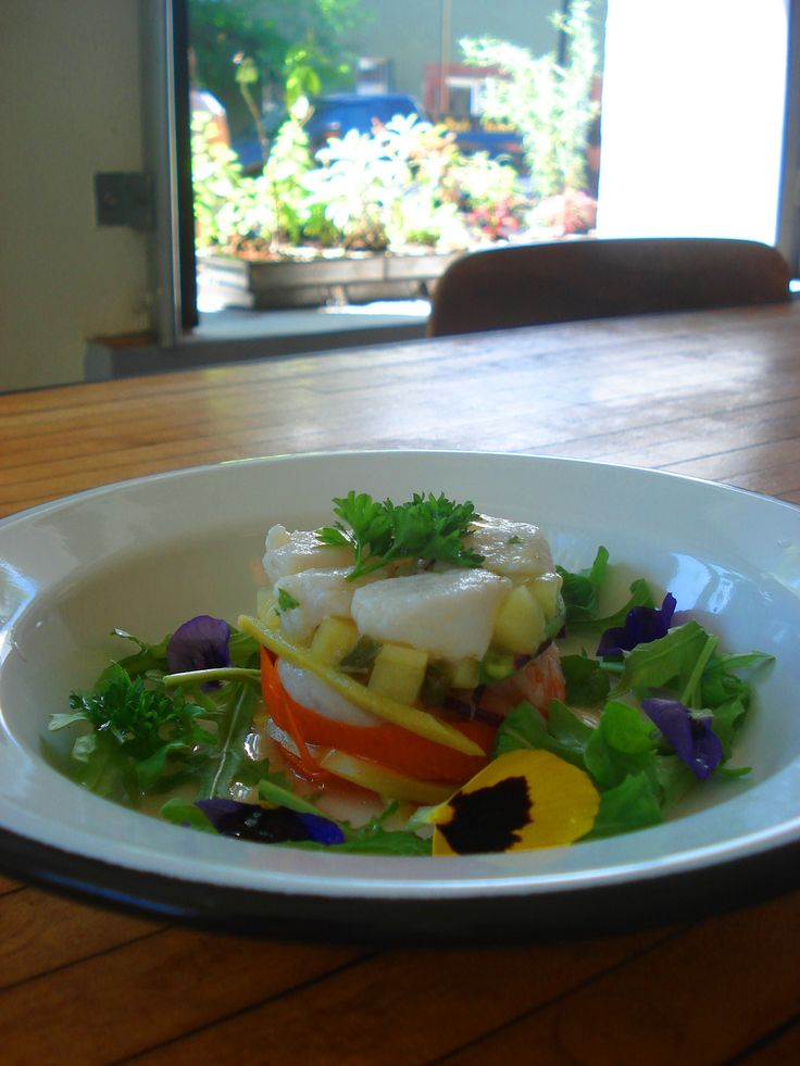 Rainbow Ceviche | Basa fish, white shrimp, lime and grapefruit juice, limo hot pepper, avocado, ginger, garlic, red onion, carrot, arugula, pickled mango, cucumber, mint, oregano, chives, parsley, flowers, olive oil and sea salt