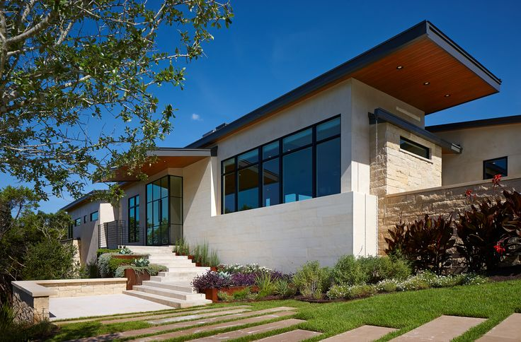 Exterior of the House on the Corner Residence - Architecture by LaRue Architects #entry #hillcountry #contemporary #modern #architecture #austintexas #steeldoor #stone