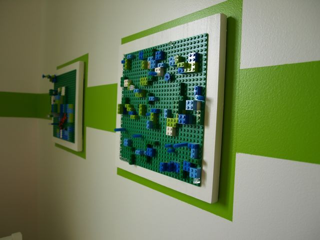 Green Lego base plates repurposed as art! If the kid gets bored, they can just change it out. Fuels their own creativity to see their work up on the walls all fancy and such. Love this idea!!!