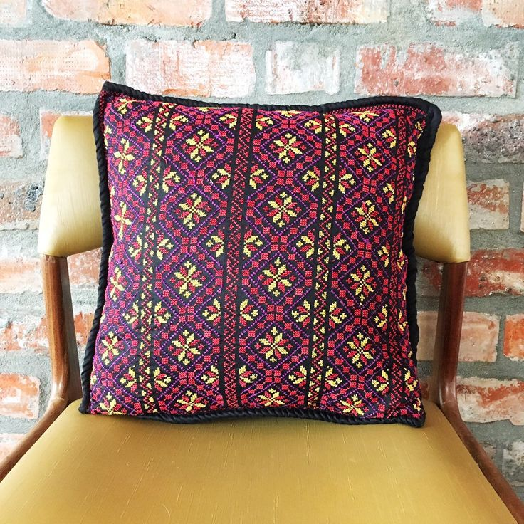 Devotedly hand embroidered on Egyptian cotton, this colourful cover with its snowflake motif – is named after Boreas ~ Greek god of the cold North wind and the bringer of winter.  Black with purple, deep red and yellow accents. 40cm x 40cm. Available @laviebohemedecor. Free delivery in South Africa.