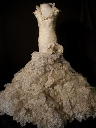 Stunning dress made out of repurposed romance novels.