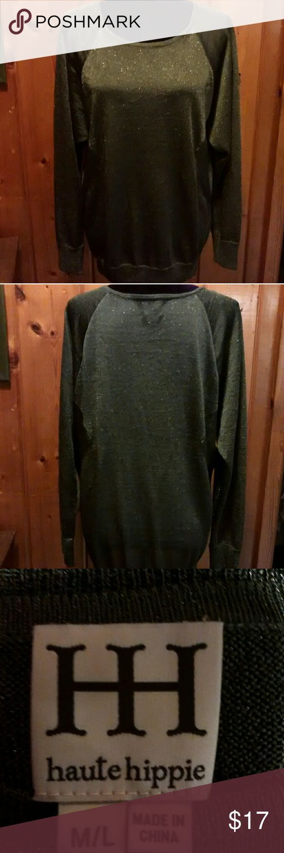Haute Hippie hunter green shimmer blouse Haute Hippie green shimmer blouse. The picture looks like it has fuzzys but it is actually the shimmery spots. Camera doesn't do it justice. Listing as size large because tag has m/L and it's pretty roomy Haute Hippie Tops Blouses