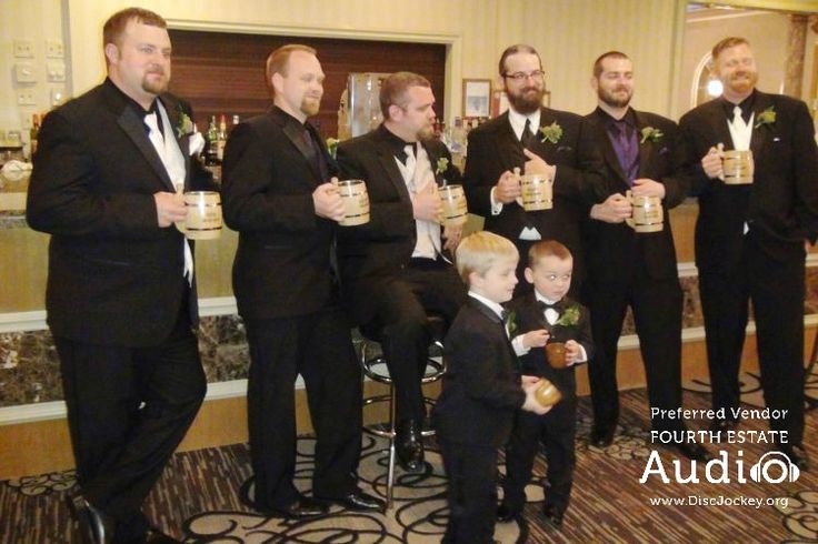 The groom and his groomsmen show off their special personalized beer steins. http://www.discjockey.org/real-chicago-wedding-may-2-2015/