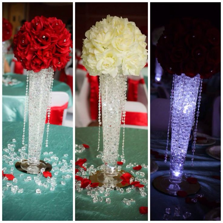 "My daughter's Quinceanera centerpieces. Theme was ""bling"" and colors were Tiffany blue and red. Vases were ordered from Vasemarket.com. They were cheap and shipped without any issues to Fairbanks, Alaska. Mirrors, clear water beads and LED lights were ordered from efavormart.com. Hanging crystals and the diamond push pins (inside the flowers) were ordered from Diamond Party Confetti. We cut them to size and hot glued them on."