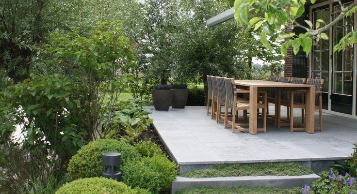 Boerderijtuin terras belgische arduin hoogteverschillen polderlandschap gerealiseerde - Tuin grind decoratief ...