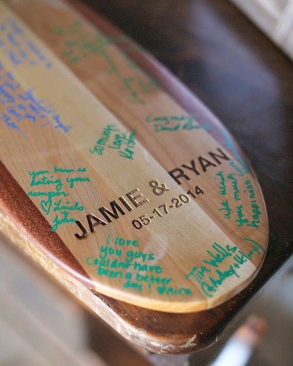A Perfect Paddle: handcrafted oar for guests to sign with instructions encouraging people to leave their mark for the couple as they navigate the waters of life together.