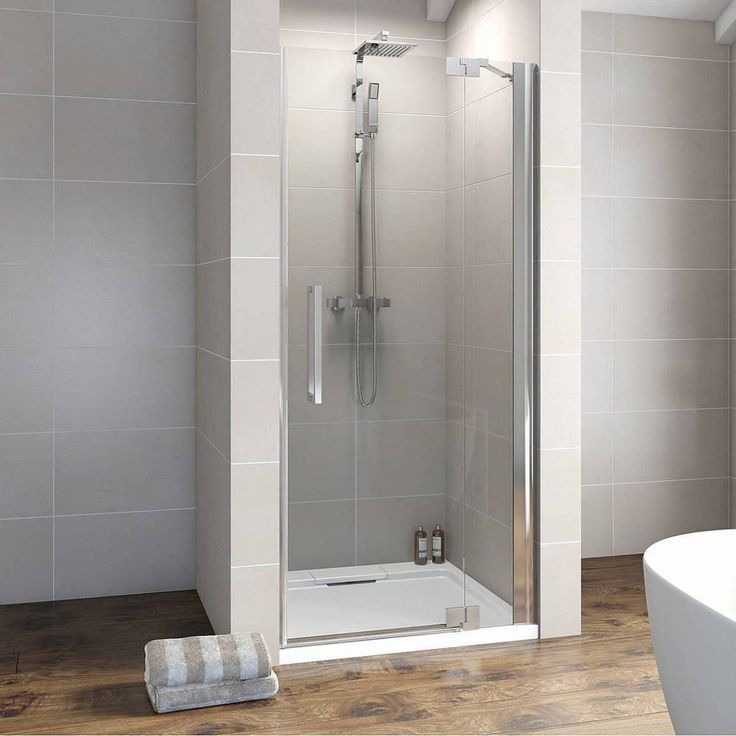 This frameless shower door creates a distinct feature whilst offering the best you could want in terms of shower enclosure manufacturing. A contemporary chrome bar handle is used to complete the ultra modern shower enclosures designer look.