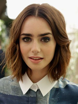 Lily Collins! That's how eyebrows should look! enough of thin eyebrows.