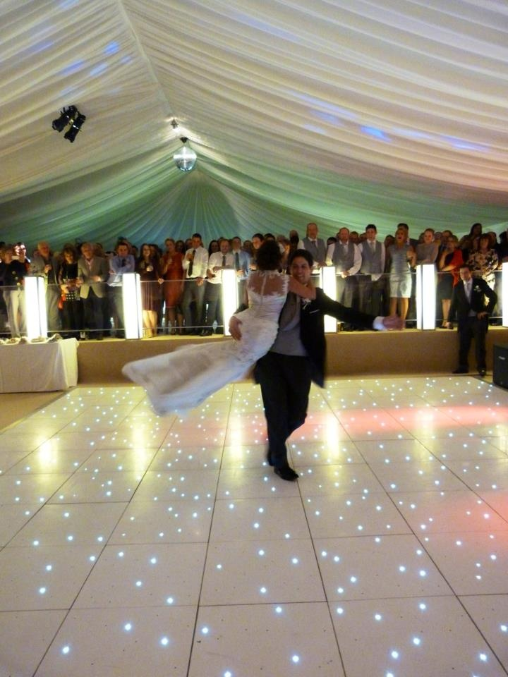Wedding dance - White LED Dance floor, ivory marquee, double level. Very special.