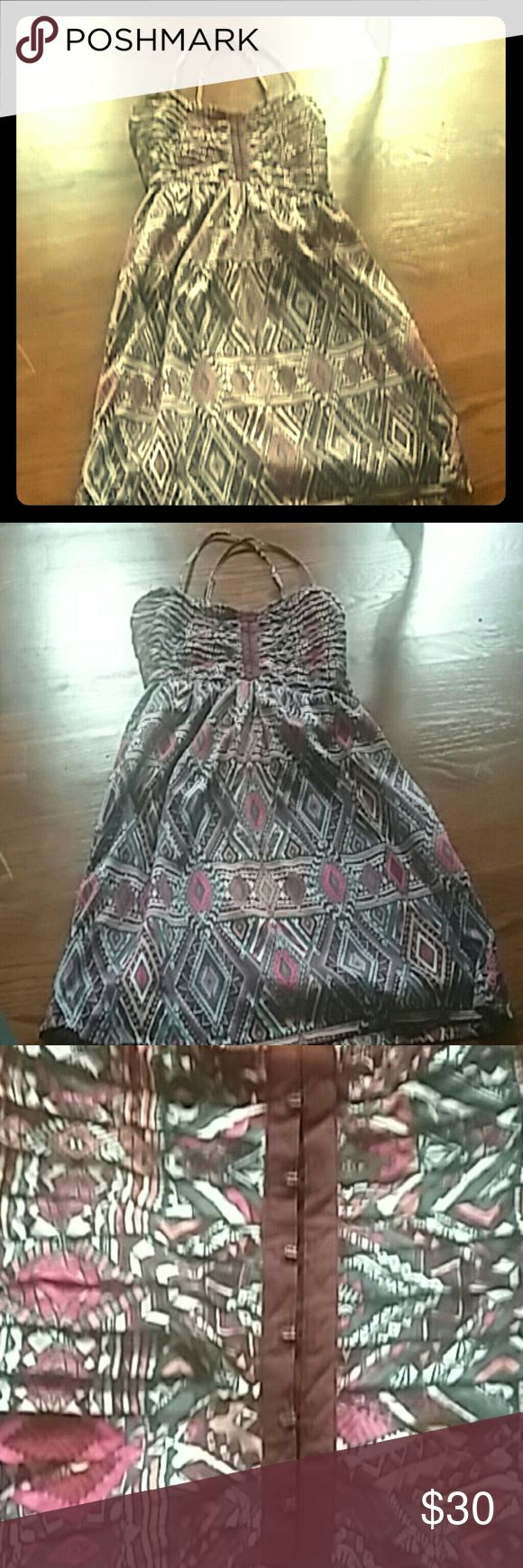 Billabong. Spaghetti  strap aztec print dress. L Billabong  spaghetti  strap multi colored  aztec print dress. L. This dress  has front clasps on the  bust area.  Side zipper. and gathering on the back. The dress has a lining  The dress was preowned with Love Billabong Dresses