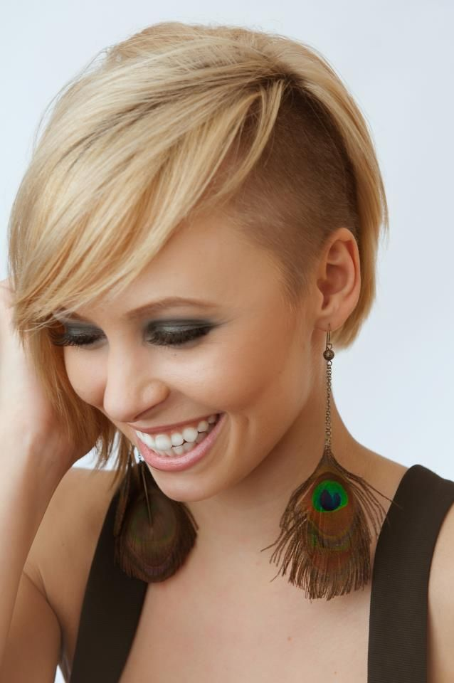 Erin sidecut - Disconnected bob, wispy fringe with a tightly tapered side. Cute, short women's cut.