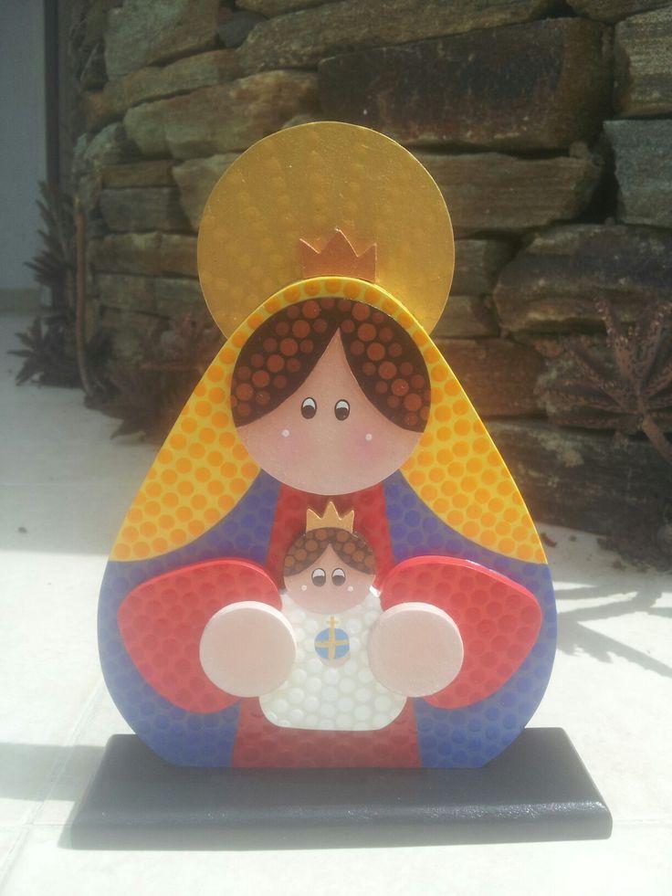 Virgen de Coromoto pintada en puntillismo con los colores de la bandera de Venezuela