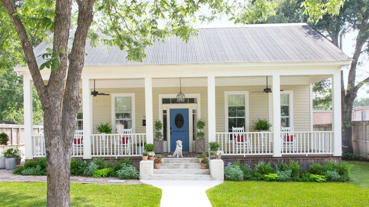 With ceiling fans, rocking chairs, symmetrical planters, and a loyal dog, this Texas home's porch couldn't be prettier.