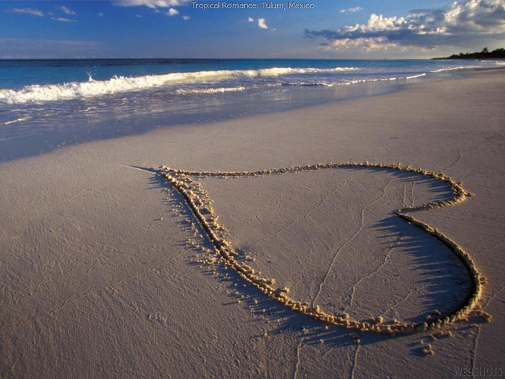 I love you carved into the sandy beach
