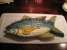 Tasty birthday cake shaped as a fish