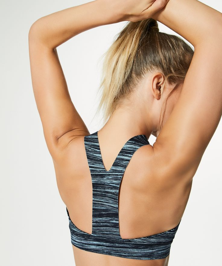 Feel supported—and secure—whether you're doing burpees, push-ups, or running in this bra thanks to its high neckline. We made it using our super soft, sweat-wicking, and four-way stretch Nulux™ fabric so the high coverage feels luxurious against your skin. The slim racerback gives your shoulders full range of movement. Slip in optional, removable cups for additional coverage—if you want it. This bra is intended to provide medium support for sweat-enthusiasts with a B/C cup.