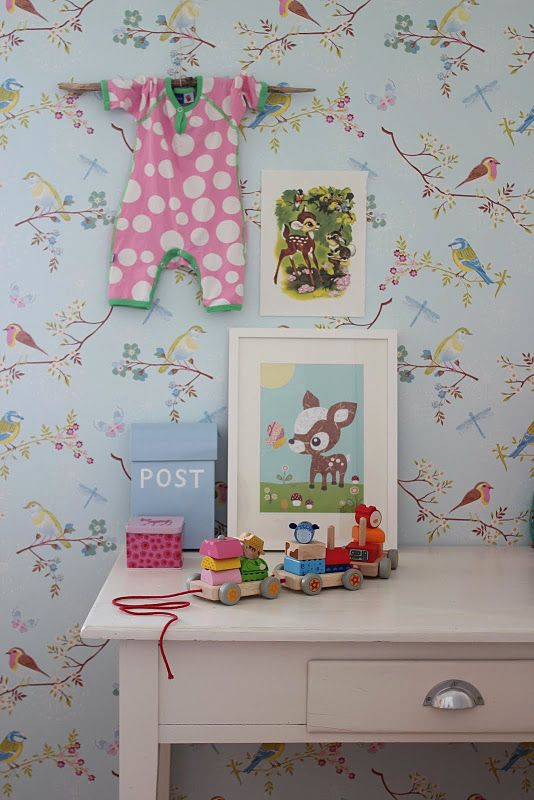 So adorable. Could be cute to hang a baby cloth item of each of the kids in their room.