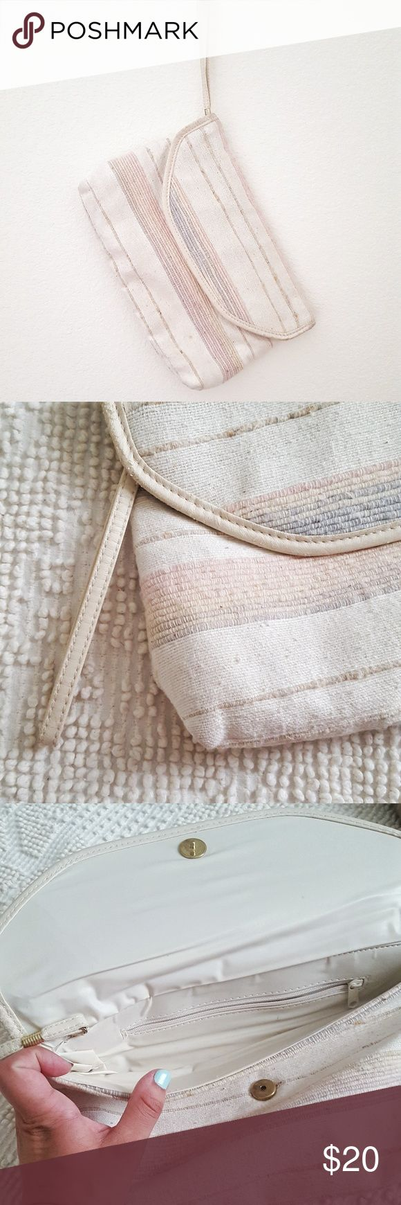 """Vintage Boho Woven Pastel Neutral Clutch Vintage clutch with fold over snap closure, interior zipper pocket, loop handle, and vinyl lining. Neutral pastel cream, tan, blush, blue with great texture. Approx. 12""""w, 8""""h, 2""""d (at base). Very good vintage condition. Vintage Bags Clutches & Wristlets"""