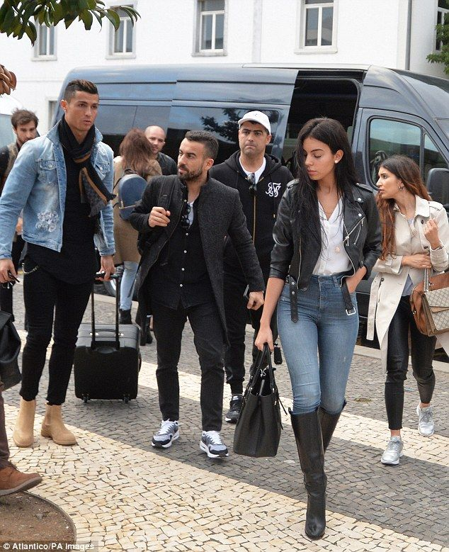 Stylish pair: Cristiano Ronaldo's fashionable new girlfriend Georgina Rodriguez strutted into their Madeira hotel... while the football star was accosted by female fans