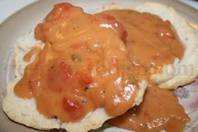 A roux based gravy made with tomatoes is traditional served over biscuits, but can be served with meatloaf, over rice, or spooned on grits...