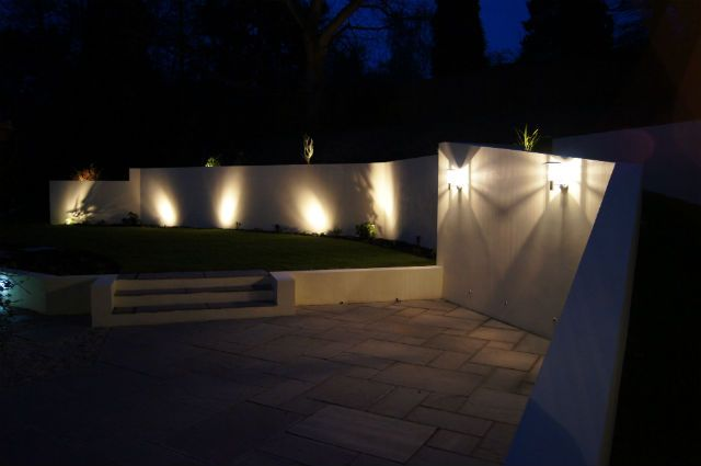 Garden Design by Evolving Spaces Landscape Designs LTD - Mood lighting can be used for a dramatic effect at night.
