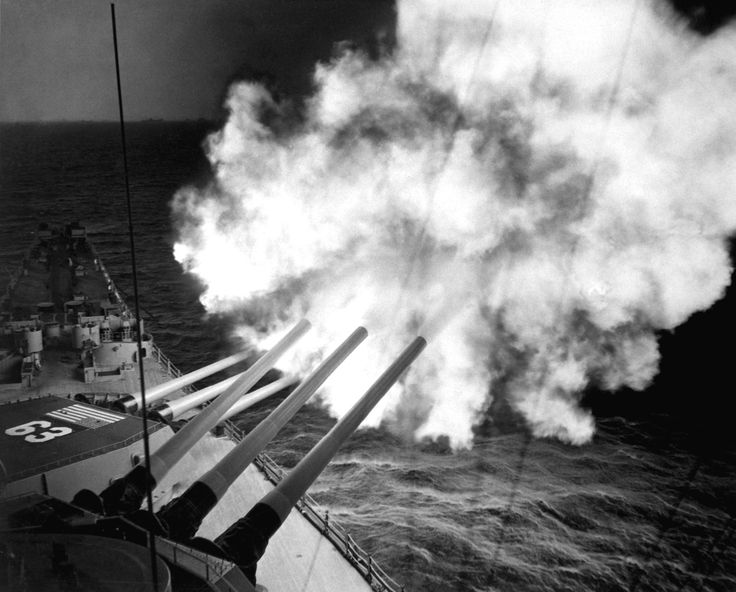 The USS Missouri bombards Communist positions in Huangnam, Korea with her 16-inch guns (December 26, 1950).