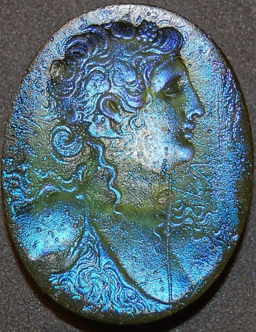 Glass Seal, 1st Century BC, Roman | Iridescent green glass seal engraved with a bust of a maenad in profile, wearing an ivy-wreath and fawn-skin. Not on display, The British Museum  http://www.britishmuseum.org/research/collection_online/collection_object_details.aspx?objectId=458396&partId=1