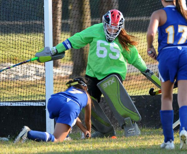 Mariner Middle School goalkeeper Kaisey Reed shuts down a Georgetown shot by Cassie Maldonado during the Vikings' 3-1 win over the Golden Knights. Click http://capegazette.villagesoup.com/p/mariner-hockey-scores-3-1-victory-over-georgetown/1063351 to read field hockey article: Mariner hockey scores 3-1 victory over Georgetown