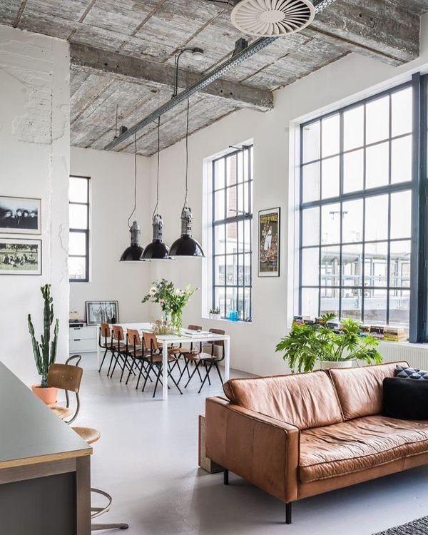 paned windows + black schoolhouse  pendants + tan leather sofa