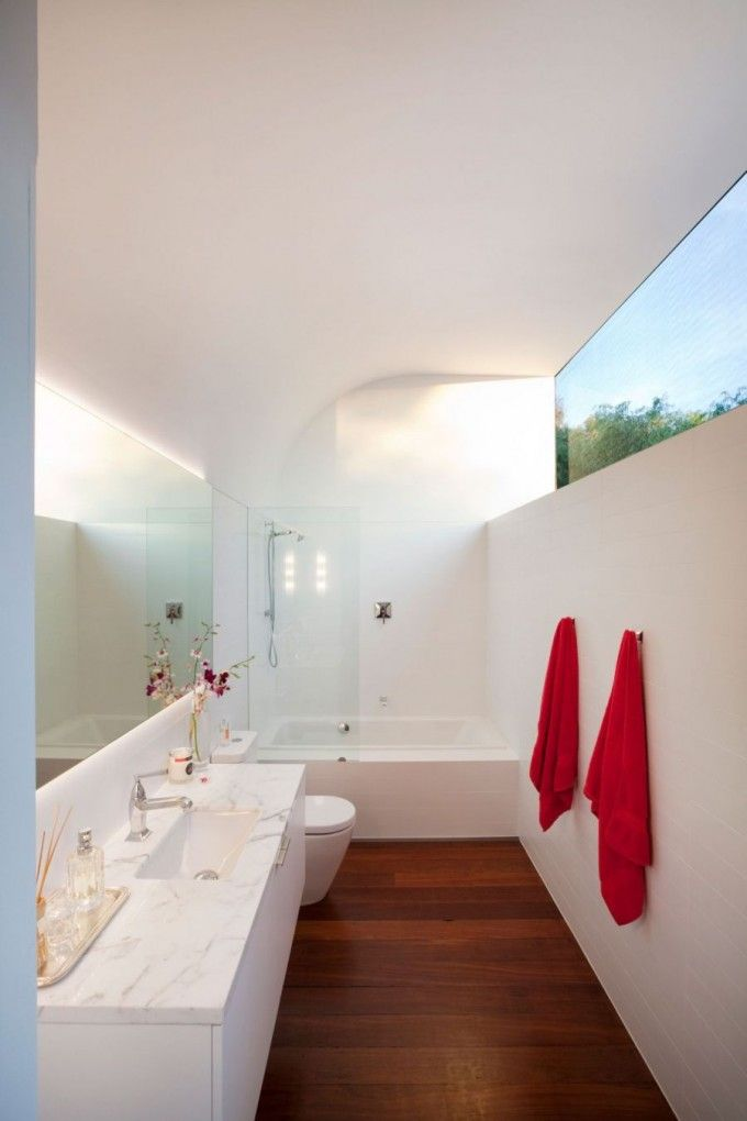 Open And Modern Bathroom Interior Setting In Long Narrowed Style With Shower And Bathtub Area Located On The Tip