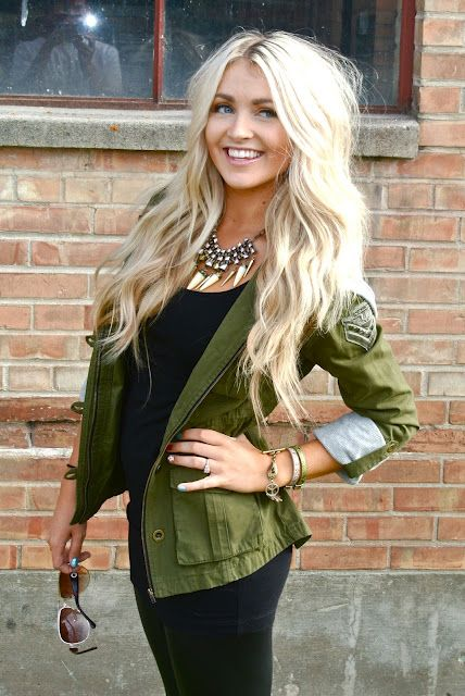 Army green jacket. Black shirt. Black jeans. Black boots. Or tan boots.