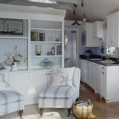 Like the built in and the hardware in the kitchen. Small space revisited. This cottage takes full advantage of its interior space. Built-in bookcases in the living area display art, shells, and novels. A drop-leaf table offers just enough room for dining or game-playing, and a sleeper sofa (not shown) makes up for the lack of a second bedroom.
