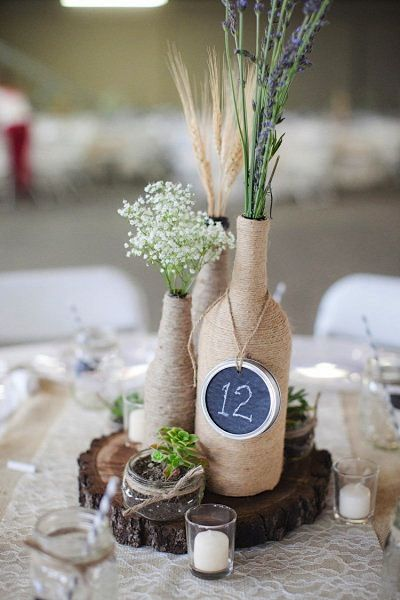love the table numbers on mason jar lid idea 7 awesome diy wine bottle centerpiece ideas for your big day