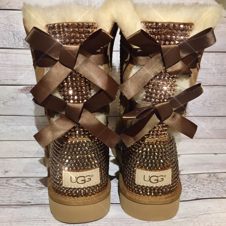Bling UGG boots - crystal UGG boots - bling snow boots - womans ugg boots - custom UGG boots- bling Chestnut ugg boots- bling uggs with bows by DAMFancyCreations on Etsy https://www.etsy.com/listing/263454022/bling-ugg-boots-crystal-ugg-boots-bling