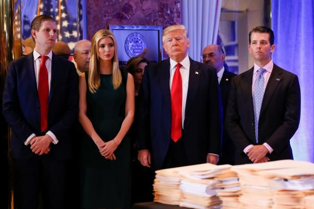 U.S. President-elect Donald Trump (C) stands surrounded by his son Eric Trump (L) daughter Ivanka and son Donald Jr. (R) ahead of a press conference in Trump Tower, Manhattan, New York, U.S., January 11, 2017. REUTERS/Shannon Stapleton