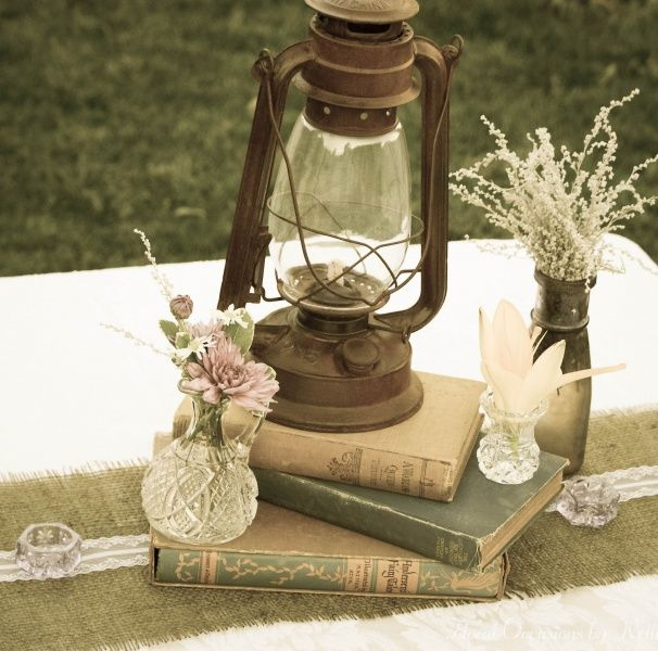 Vintage books and rustic lantern with burlap & lace
