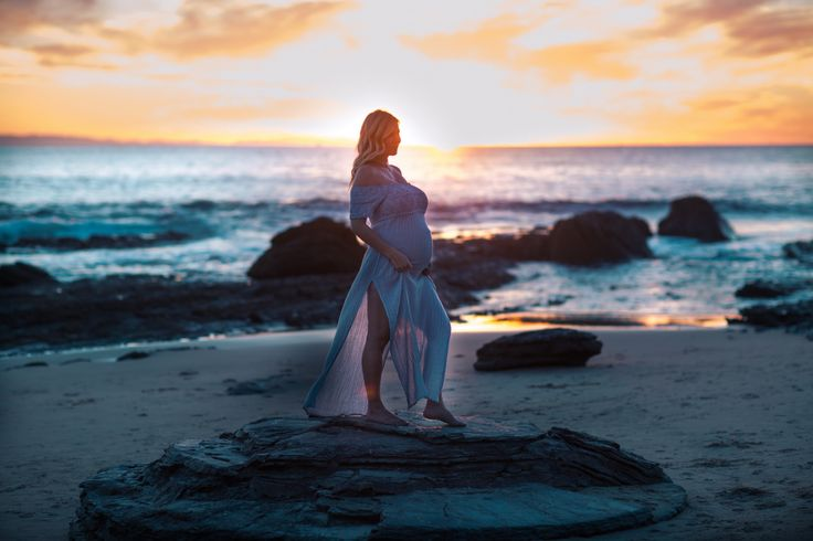 Laguna Beach maternity photographer Nicole Caldwell, shooting on the sands of Crystal Cove Beach