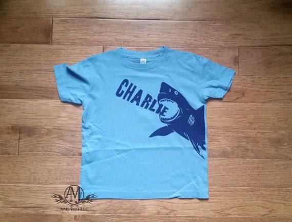 """Personalized shark t shirt t shirt for boys. This t shirt is great for shark birthday party, or personalized gift, even a shark week t shirt! Customize the t-shirt, Pick your colors, add the name and make it yours!.  Please indicate the following in the """"Message to Seller"""" at checkout:  * Size * Apparel Color * Design color * Name ______________________________  Infant onesie: Newborn, 6 Months, 12 Months, 18 Months, Infant t shirts: 12months, 18months  Toddler Sizes: 2T, 3T, 4T, 5/6T Youth…"""