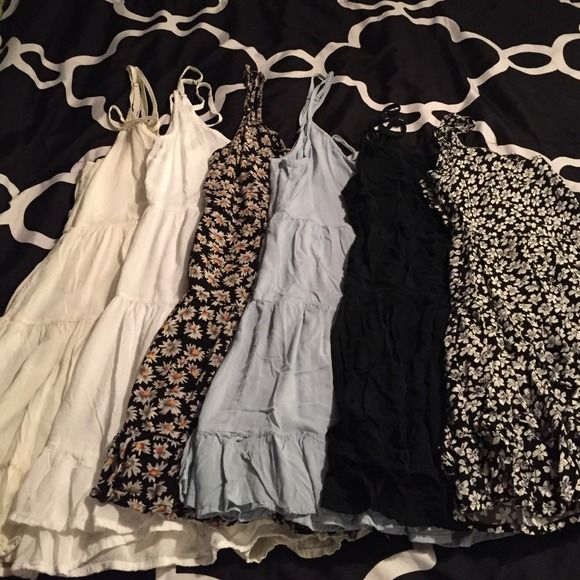 Brandy Melville jada dresses From left to right: cream, white, small daisy, light blue,black and floral. $30 each, price is firm. All like nwot Brandy Melville Dresses
