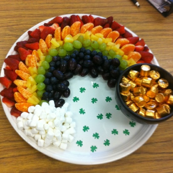 "While 3 blonde kids named LaRouche doesn't scream Irish, this is a great St Patricks's Day (or anytime)treat. The fruit rainbow is made with strawberries, oranges, pineapple, green grapes, blueberries and purple grapes. The clouds are mini marshmallows and a ""pot of gold"" Rolos."