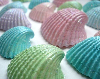 Seashell Place cards. Paint seashells in different colors  be sure to add glitter too. Then using a nice card stock write each guests name on a circle shape and hot glue it to the sea shell.