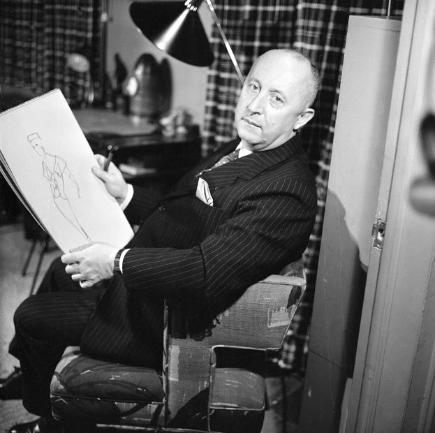 Christian Dior at work in 1955.