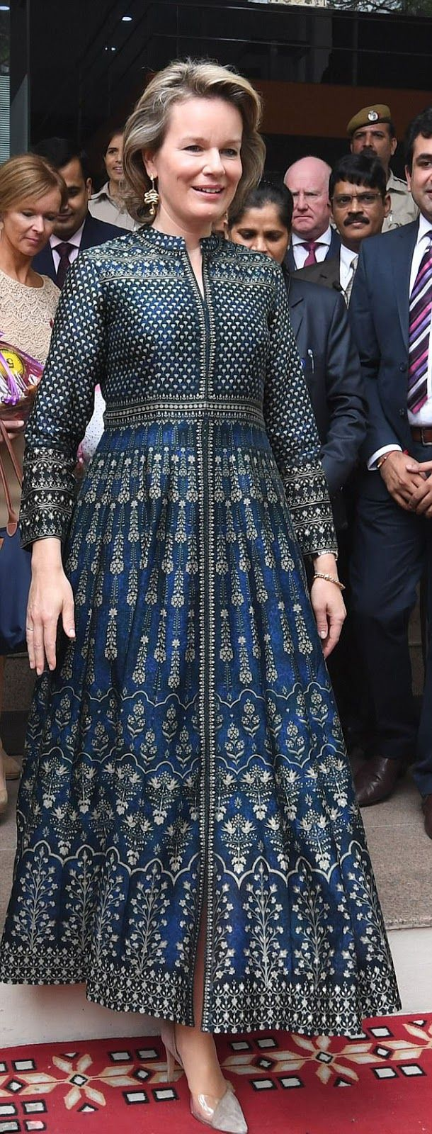 Queen Mathilde of Belgium opts for an unusual choice of shoe design, giving a little bit of an edge to the traditional outfit during their state visit in Gurgaon, India