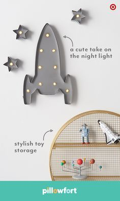 Make kid-room walls pop with personality. Pillowfort's rocket marquee lights have a fun, vintage appeal, and a stylish shelf also works as storage and decor—it's a win-win!