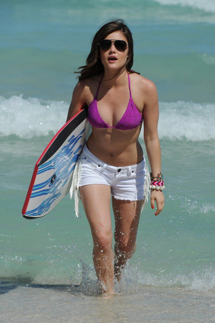 Pin for Later: The Ultimate Celebrity Bikini Gallery  Lucy Hale wore a purple bikini top and white cutoff shorts while visiting the Bongo Beach Shack in Miami in March 2012.