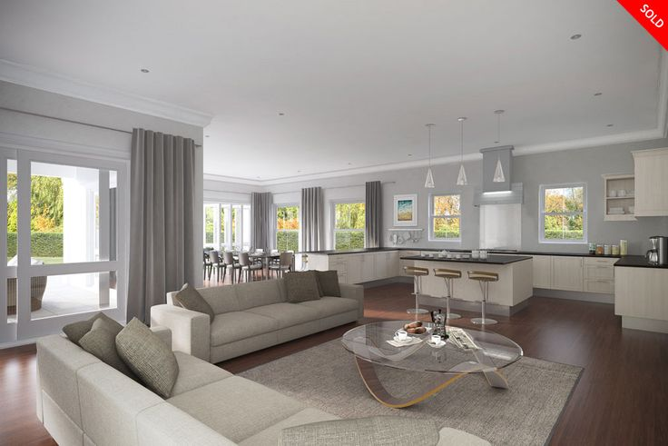 Chacombe House interior. Large open plan lounge, kitchen and dining room area. Large sliding doors along walls and wooden floors. An elegant and luxurious feel, still with the element of family presence.