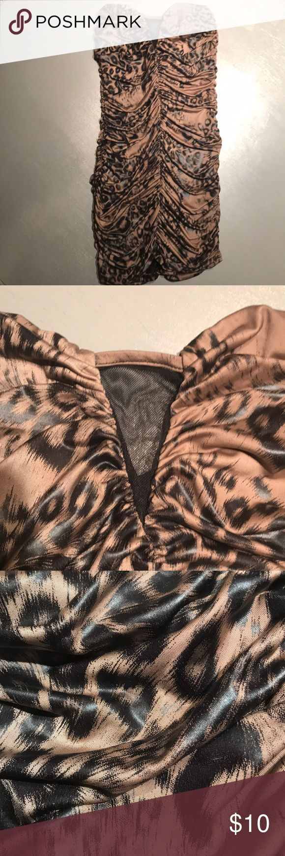 Fitted cheetah dress Comfortable, stretch fitted strapless cheetah dress with sheer cutout peekaboo cleavage. Forever 21 Dresses Mini
