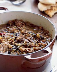 Iraqi Lamb and Eggplant Stew with Pitas  This sweet and tangy Middle Eastern stew features falling-apart-tender lamb.